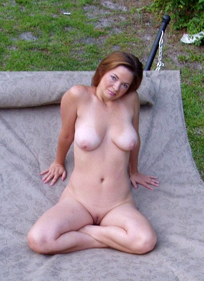 Naked chick in garden
