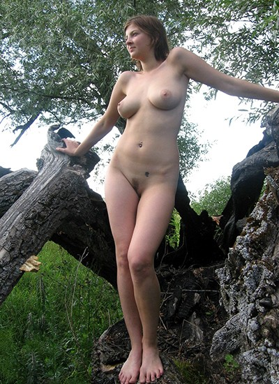 Chick in forest getting nude